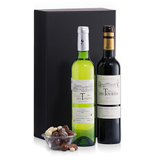 A classic and elegant gift of French Bordeaux wine (one red and one white) from Château des Tourtes and oh-so-satisfying chocolate-covered nuts.