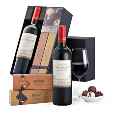 Intense rich Bordeaux red wine is paired with luxury Neuhaus Belgian chocolates and biscuits in this stylish red wine gift set.