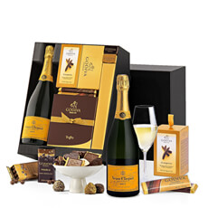This gorgeous Veuve Clicquot gift basket features an indulgent selection of Godiva's finest offerings.