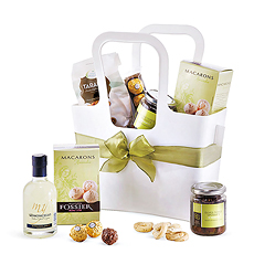 Discover the classic lemon, olive, almond, and chocolate flavors of the Mediterranean in this gourmet gift set. We've tucked gourmet sweets and savories from Italy and France into a versatile Koziol tote bag.