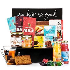 An abundance of Oxfam Fair Trade chocolate, cakes, and spreads await in this fun family gift box. The sweet breakfast gift set is completed with Fair Trade juices and organic tea.
