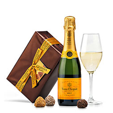 Discover the perfect pairing of Godiva truffles and Veuve Clicquot Brut Champagne in a luxury gift set that is meant for sharing.
