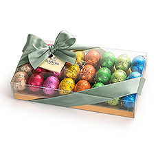 Welcome spring with Godiva's vibrantly colored foil-wrapped 24 mini chocolate Easter eggs.