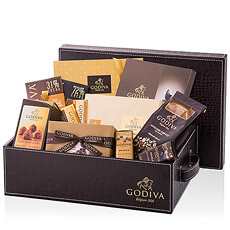 The Godiva Executive Gift Hamper is an ideal corporate gift for the holidays, group gift for offices, and VIP client gift. An abundance of Godiva Belgian chocolates, truffles, chocolate squares, biscuits, coffee, pearls, and more are presented in a luxury gift hamper.