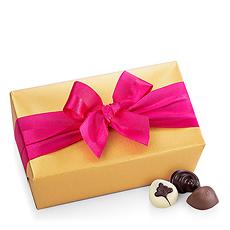 Celebrate spring with Godiva's elegant Belgian chocolate ballotin dressed up in seasonal wrapping, a timeless indulgence