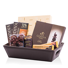 This leather chocolate hamper filled to the brim with dark chocolate treats is a dream come true for any dark chocolate fan.