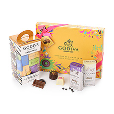Cet ensemble cadeau unique vous permet de savourer la nouvelle collection Chocolate Carnival, les délicieux Napolitains colorés et les mini-perles croustillantes de chocolat noir et blanc.