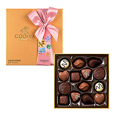 Discover our iconic chocolates, carefully selected to offer a wide range of the finest fillings to suit all tastes. The popular Gold Rigid Gift Box is decorated with a pretty pink satin bow for her.