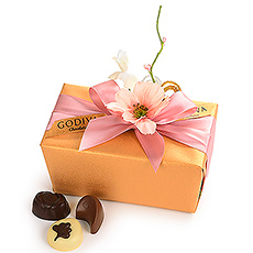 This classic Godiva favorite is decorated with a lovely pink satin ribbon and beautiful pink flower for Mother's Day.