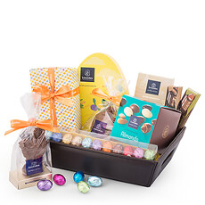 A stylish faux-leather gift basket is packed with a whole range of Leonidas chocolate delicacies to enjoy the entire Easter season.
