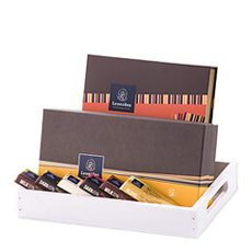 This Leonidas gift tray is a wonderful choice for one lucky chocolate lover, as well as for a family or office to share. An exquisite collection of their signature Belgian chocolates, Napolitain squares, and scrumptious chocolate bars are presented in a chic white wooden gift tray.