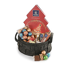 There's something for everyone in this great woven gift basket filled with Leonidas Christmas chocolates.