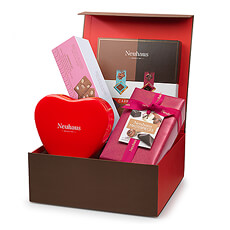Send your love with this beautiful gift set filled with our favorite chocolate hearts.