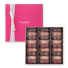 Delight your special someone with this indulgent collection of the Neuhaus Irrésistibles, which are an icon of Belgian chocolate tradition. Presented in a luxurious fuchsia Prestige box.