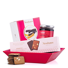 Make it a happy celebration with a delightful Neuhaus sweets gift basket. Every woman will love this collection of treats, beautifully presented in a vibrant pink and red hamper.