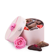 This beautiful chocolate gift is ideal for girlfriends or moms. A feminine pink round gift box with Neuhaus Belgian chocolates is presented with a beautiful pink rose to make her feel cherished.