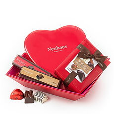"Luxury Neuhaus chocolate is presented in a beautiful red and pink ""leather"" gift basket for a sweet romantic treat."